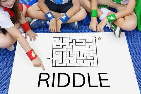 Superhero kids solving enigma concept together Stock Photo