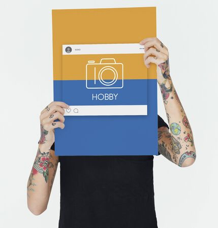 Woman holding placard with camera icon
