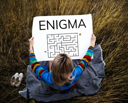 enigma: Woman holding enigma concept card