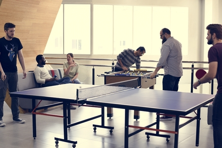 People break playing table tennis relax