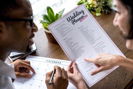 Couple decision for wedding planner Reklamní fotografie