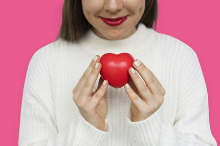 res: Smiling girl holding a res heart