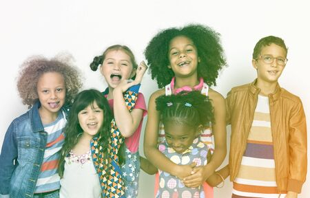 Group of children standing and posing Stock Photo