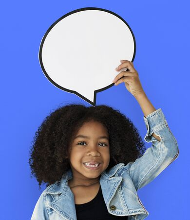 Little Girl Holding Chat Bubble Smiling Stock Photo - 82025503