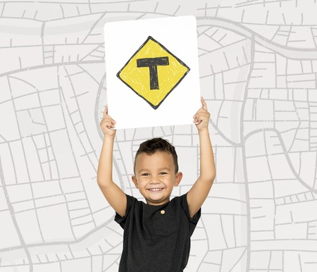 the roadside: Young boy holding network graphic overlay banner Stock Photo