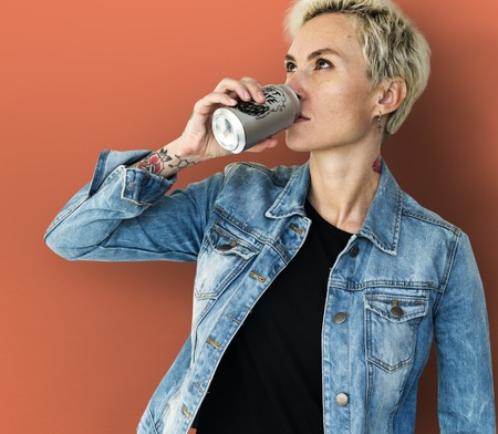 Adult Woman Drinking Beverage from Can Banco de Imagens