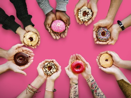 People holding donuts Stock Photo