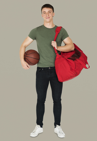 Young adult muscular man holding basketball Stock Photo