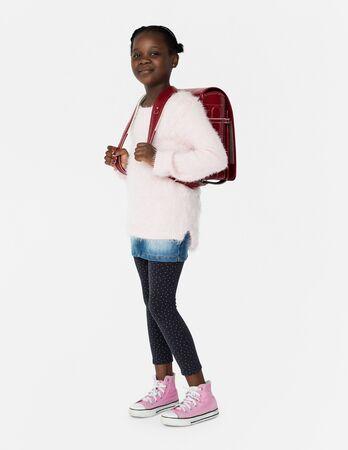 バックパックの全身肖像画で若い学生 写真素材