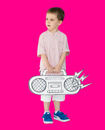Young boy carrying a music boombox
