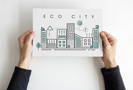 Hands holding paper building eco city graphic