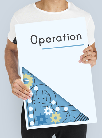man holding advertising banner with operation word Imagens