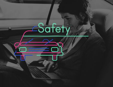 Businesswoman Using Laptop in the Car and Graphic Icon Stock Photo