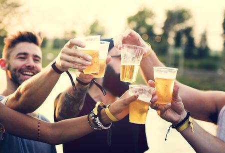 Group of Friends Drinking Beers Enjoying Music Festival Together Reklamní fotografie - 82092848