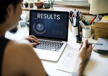 asian man laptop: Graphic of business graph data analysis on laptop Stock Photo