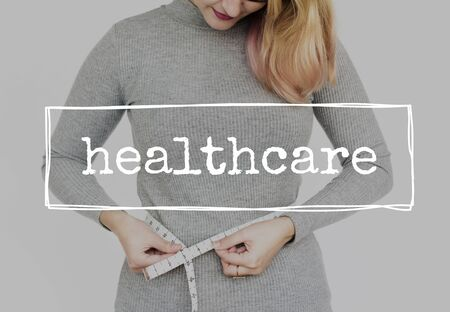 Woman  Measuring Waist Length Healthcare Lifestyle Stock Photo