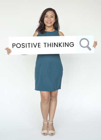 People holding and showing the positive thinking word