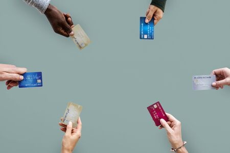 technology transaction: Group of hands holding credit card convenience life with copy space in aerial view Stock Photo