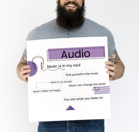 electronic music: Man holding network graphic overlay billboard Stock Photo