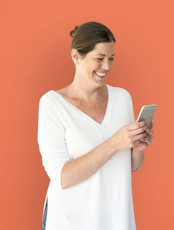 Adult Woman Using Mobile Phone Cheerfully Stock Photo