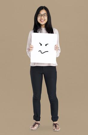 Asian girl holding placard studio portrait Stock Photo - 82101413