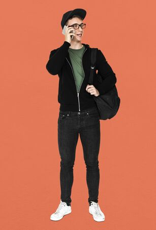 techie: Young man with casual outfit talking phone standing