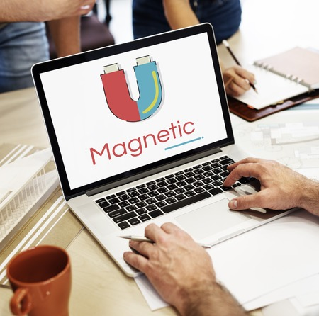 Illustration of horseshoe magnetic field energy on laptop Reklamní fotografie