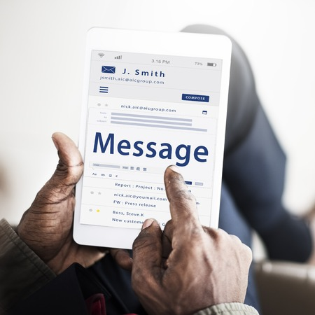 webmail: Hands composing an email on a digital device