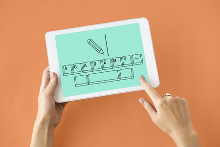 course development: Online education pencil and keyboard graphic Stock Photo