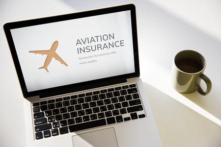 compensation: Illustration of aviation life insurance traveling trip on laptop