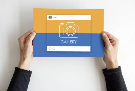 Hands holding placard with sociak media camera icon