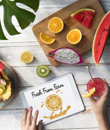 Illustration of nutritious juicy orange on digital tablet Stock Photo