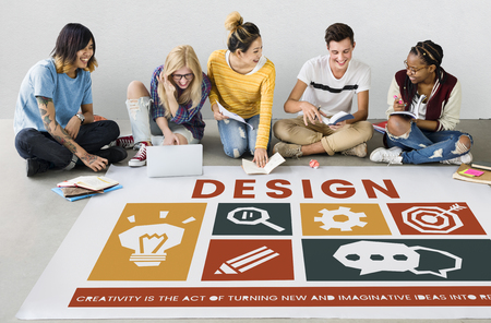 Diverse sitting on the floor discussing creative icons banner Stock Photo