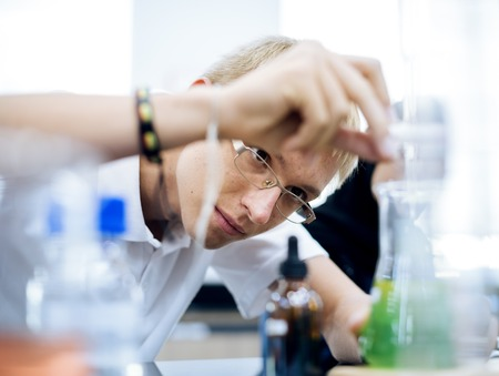 High school students studying in chemistry laboratory experiment class Stock Photo