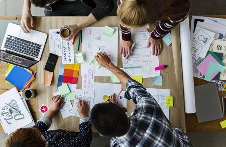 paper sheet: Group of people brainstorming meeting in the room