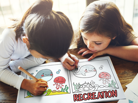 modern innovative: Children working on book network graphic overlay Stock Photo