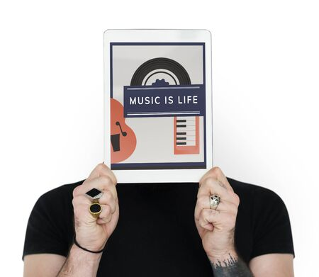 electronic music: Man holding digital device covering face network graphic Stock Photo