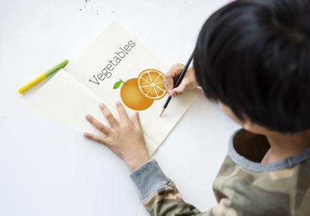 Boy with Illustration of fresh organic orange Stok Fotoğraf