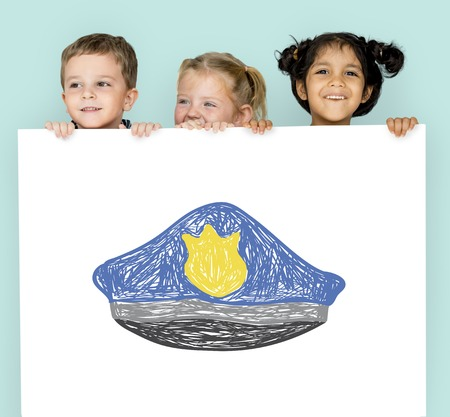 Children with a drawing of police hat Reklamní fotografie - 82416619
