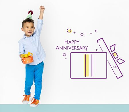 Little boy with illustration of happy anniversary gift box present Stock Photo