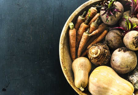 Raw organic fresh vegetable in a wooden bucket Stock Photo
