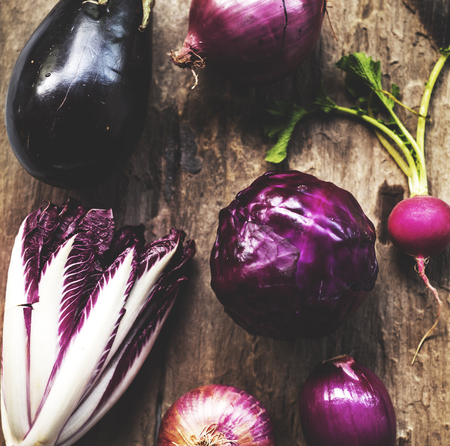 Purple vegetables on a wooden