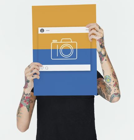 Woman holding placard with camera icon Stock Photo - 82266507
