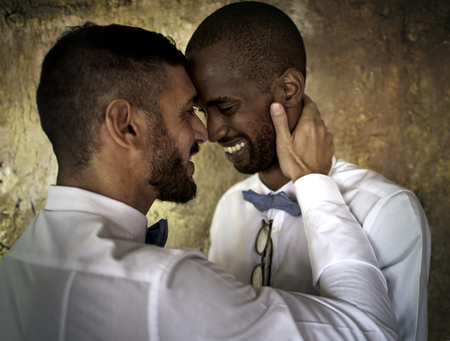 Closeup of Gay Couple Smiling Together Фото со стока