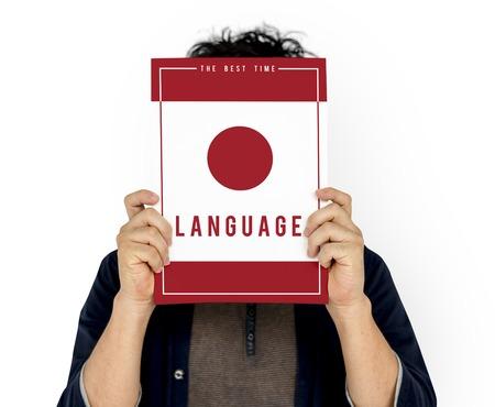 Man holding banner covering face network graphic overlay Reklamní fotografie