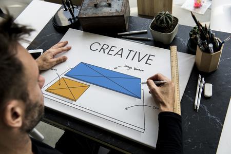 Man working on billboard network graphic overlay on table 版權商用圖片