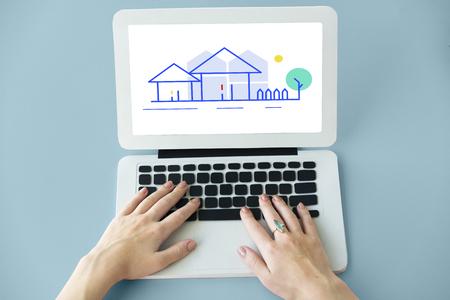 Hands working on laptop network graphic overlay Banco de Imagens