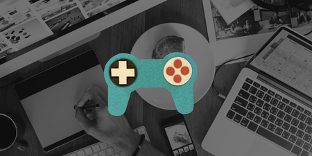 Man using computer with game controller icon