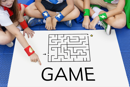 enigma: Superhero kids solving enigma concept together Stock Photo