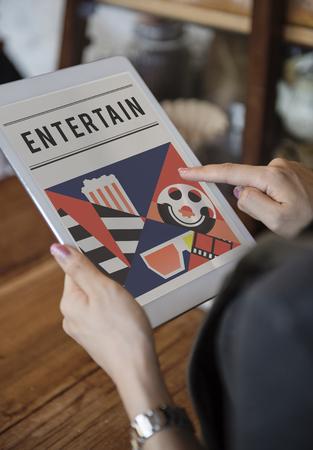 Woman enjoy movies theatre media entertainment on digital tablet